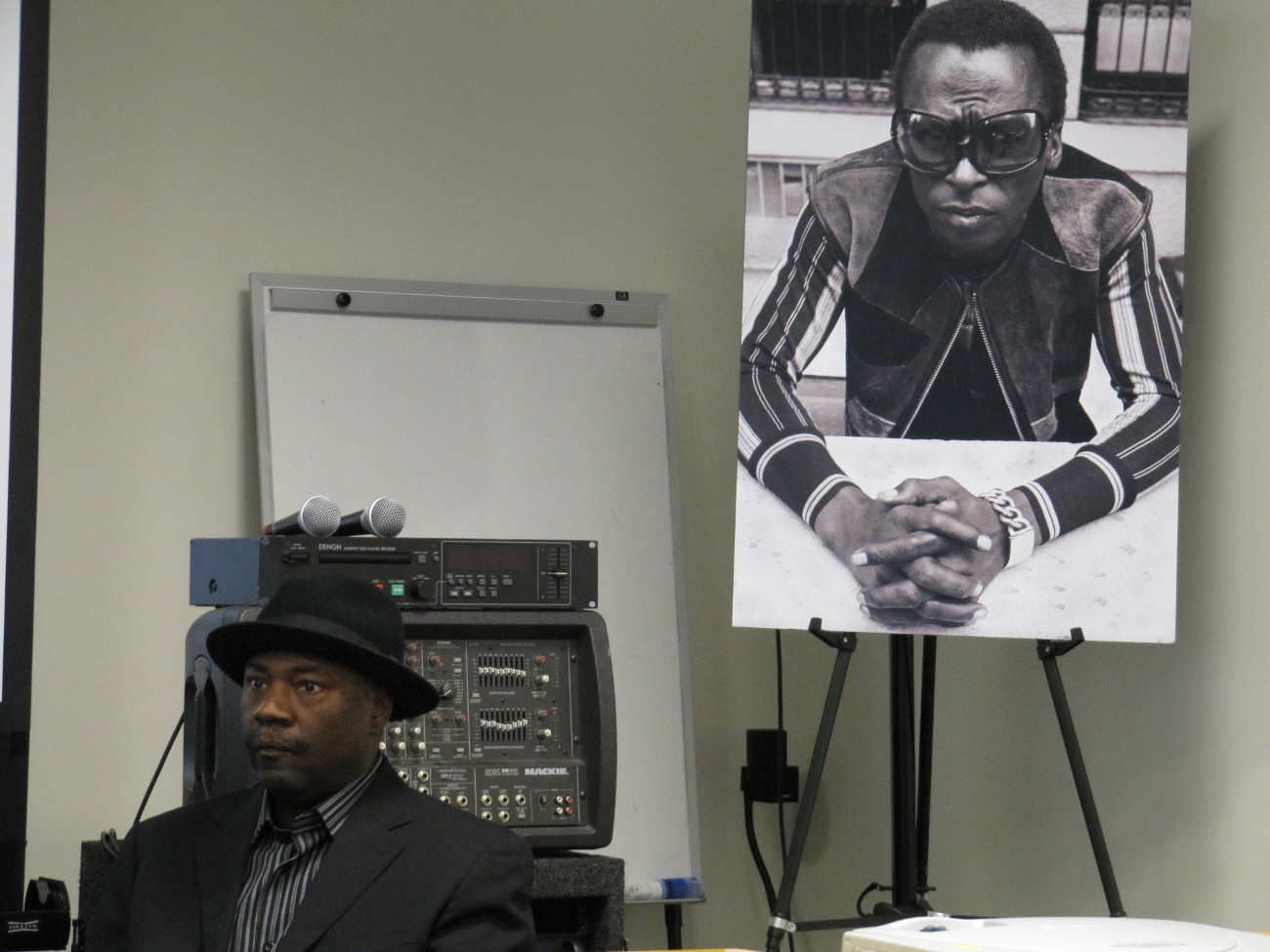 Lenny White with Miles Davis photo in the background