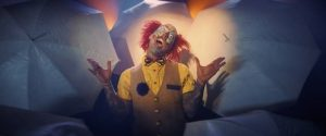 A clown is overcome with joy; screencap from Worst Nites music video