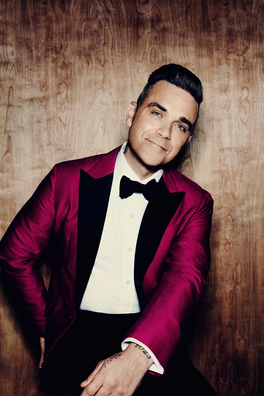 Imagen de Robbie Williams músico del género Pop activo en Los 90s