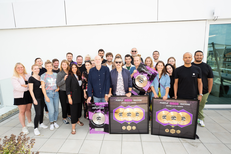 "Purple Disco Machine celebrates multiple gold and platinum awards for ""Hypnotized"""