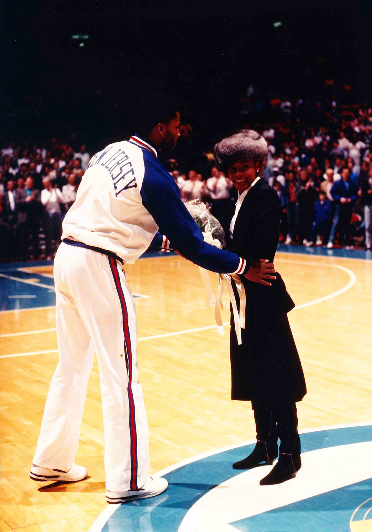 Whitney Houston sings The Star Spangled Banner before a Nets-Lakers basketball game on December 14, 1988