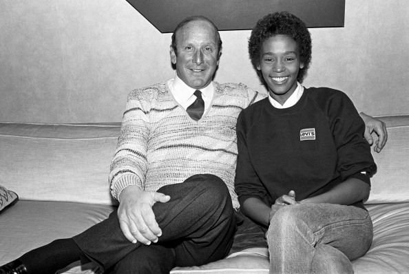Whitney Houston and Clive Davis photographed at the signing of her contract with Arista Records at the Arista Studio in New York, on April 10, 1983