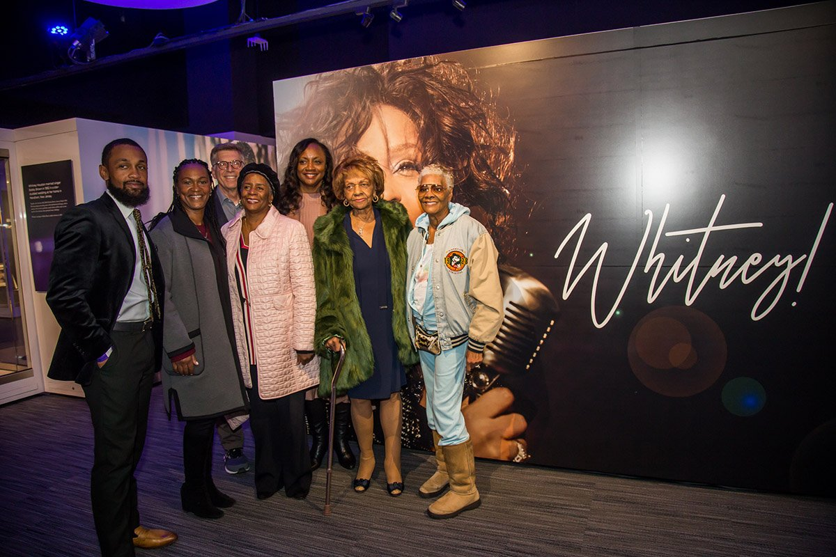 Whitney's family members and Bob Santelli, Executive Director of The Grammy Museum at entrance to exhibit: Gary Michael Houston, Donna Houston, Vice President of The Estate of Whitney E. Houston, Bob Santelli, Diane Whitt (Cissy's niece), Pat Houston, Executor of The Estate of Whitney E. Houston, Cissy Houston and Dionne Warwick at VIP reception October 18, 2018