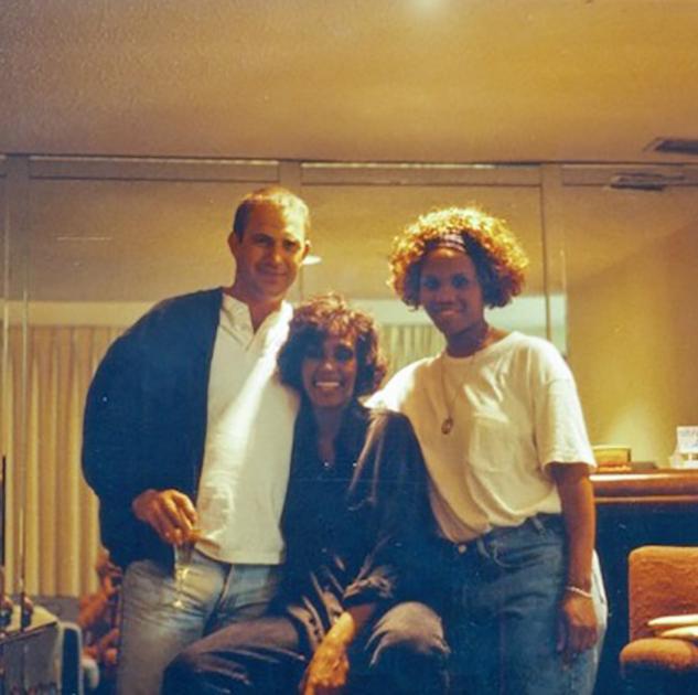 Whitney Houston and Kevin Costner on set of The Bodyguard. Photo courtesy of The Estate of Whitney E. Houston.