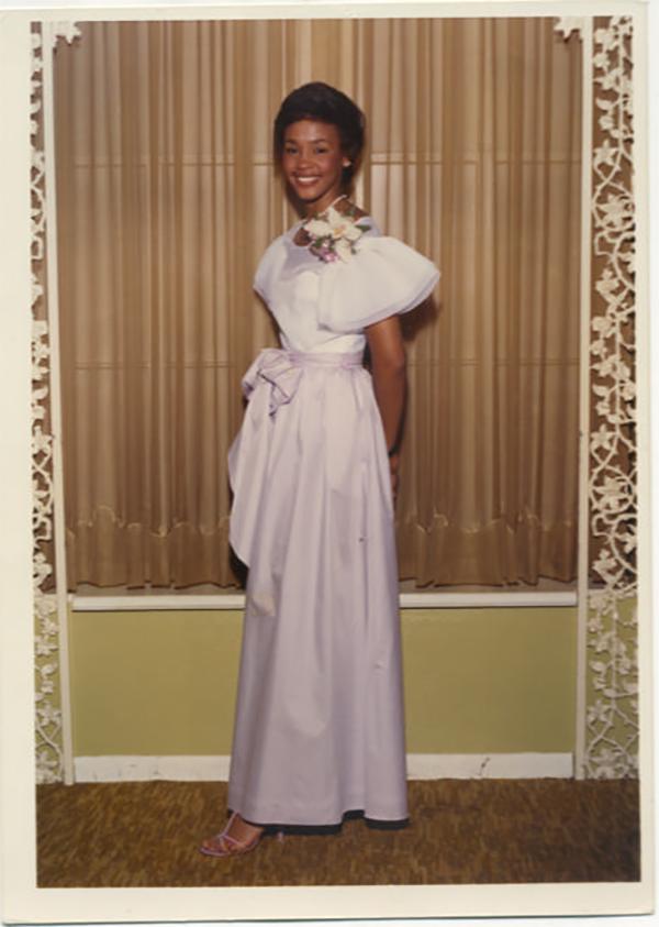 Whitney Houston wearing lavender high school prom dress